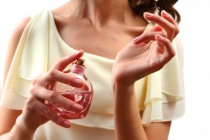 bigstock-Woman-spraying-perfume-on-her-90303971 (1)
