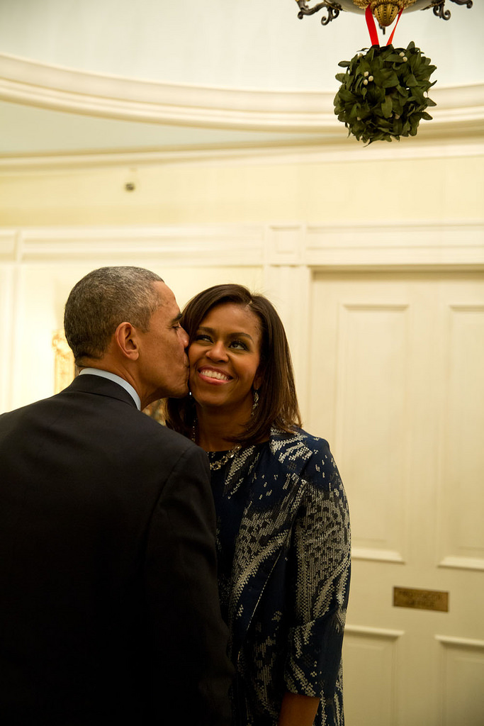 Obama kissing his wife