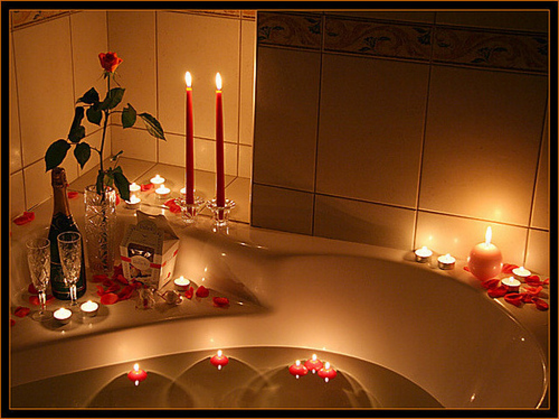 remarkable-romantic-bath-lighting-using-long-and-short-red-candles-added-with-small-floating-candles