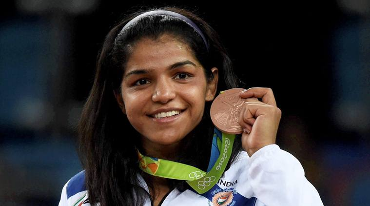 Rio de Janeiro: India's Sakshi Malik poses with her bronze medal for the women's wrestling freestyle 58-kg competition during the medals ceremony at the 2016 Summer Olympics in Rio de Janeiro, Brazil, Wednesday. PTI Photo by Atul Yadav(PTI8_18_2016_000010A)