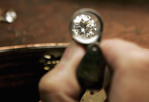"LONDON - DECEMBER 07: A jeweler examines a brilliant cut 1.01 carat diamond on December 7, 2006 in London, England. The UN General Assembly passed a resolution on December 4, 2006 backing the Kimberley Process, a global initiative aimed at preventing ""conflict diamonds"" from funding warfare and civil unrest. The issue will be highlighted by the forthcoming release of the new Leonardo Di Caprio film ""Blood Diamonds"" (Photo by Bruno Vincent/Getty Images)"