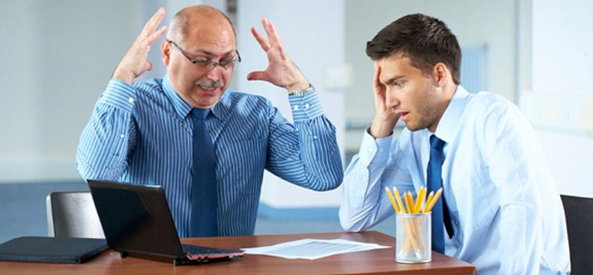 two-businessmen-talking-in-office-shock_pan_13822