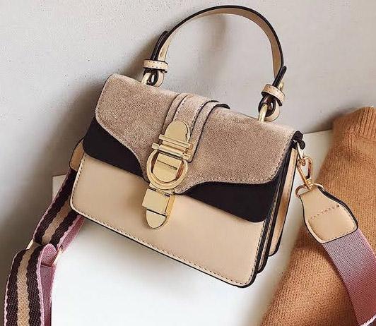 brown women's handbag on myntra
