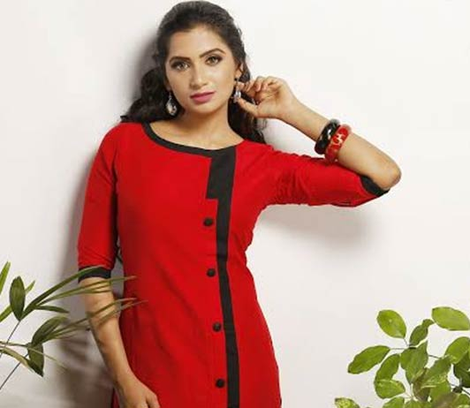 girl in red kurti with black buttons