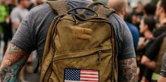 brown backpack with usa flag