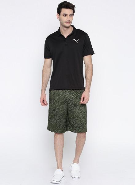 green printed puma shorts