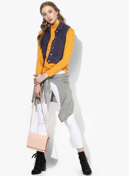 Sleeveless Denim Jacket with White Pants